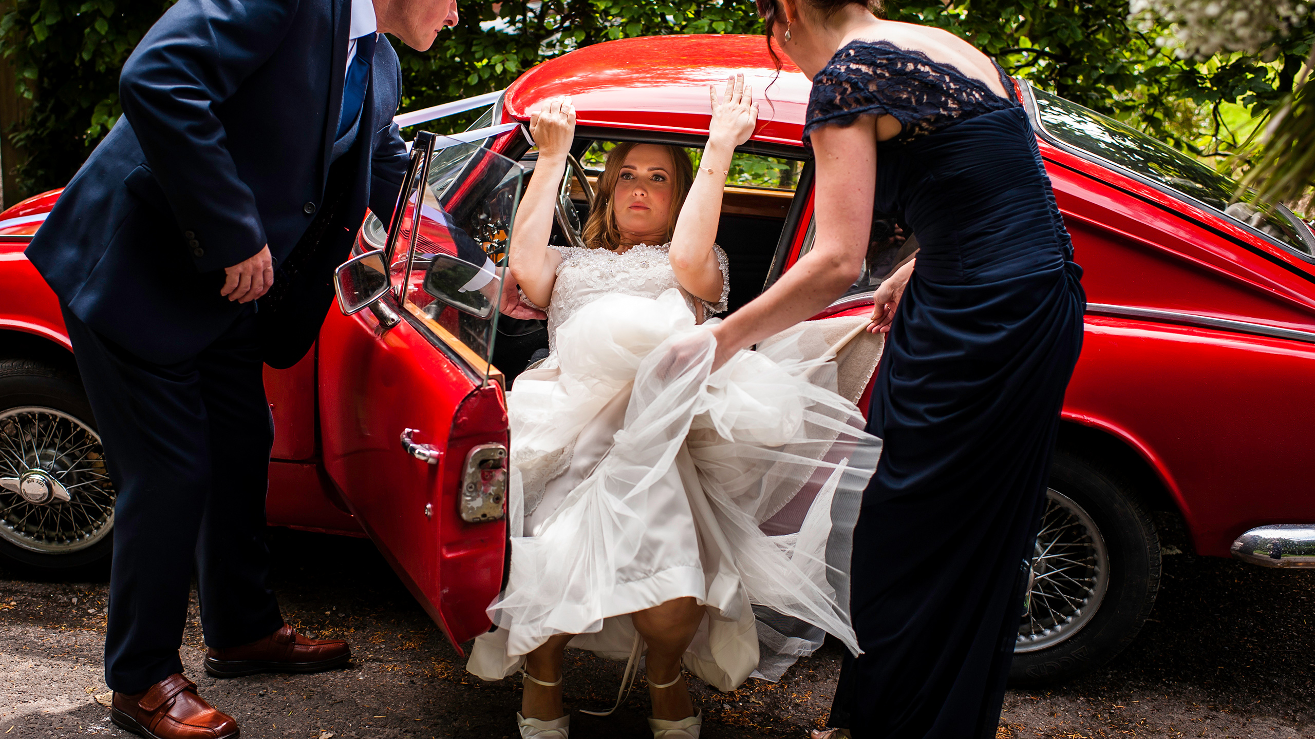 Catherine is photographed exiting the wedding car before her Kent Church ceremony