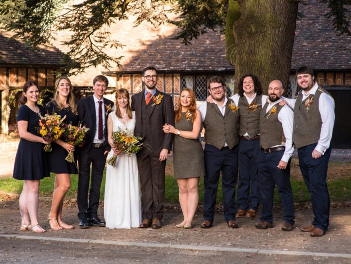 Photograph of Paul and Laura with their bridal party on their wedding day at Chilham Village Hall in Kent