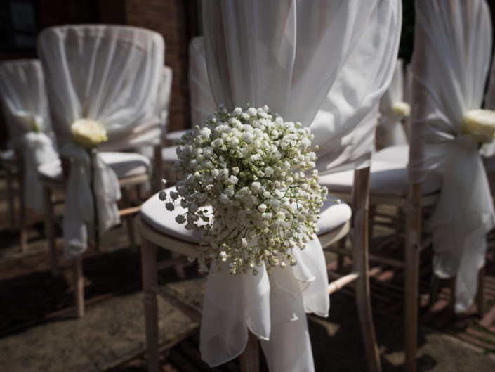 Photograph of wedding chair covers at David and Simons wedding at Port Lympne in Kent