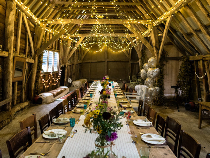 Kent wedding photographer Helen Batt photographs interior of barn reception venue for Jane and Stevens wedding