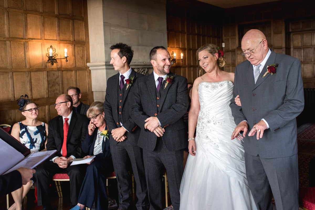 Wedding photography at Lympne Castle in Kent. Leanne's dad before presenting his daughter to John during the ceremony