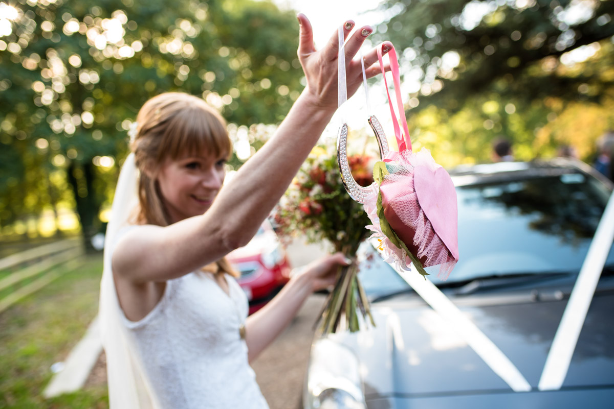 Laura is photographed holding her wedding gifts