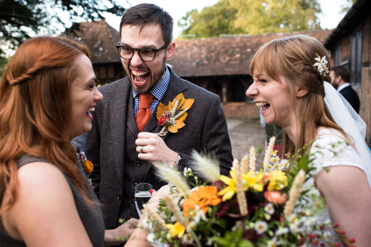 Paul and Laura share a joke with his sister at their Chilahm Village hall wedding