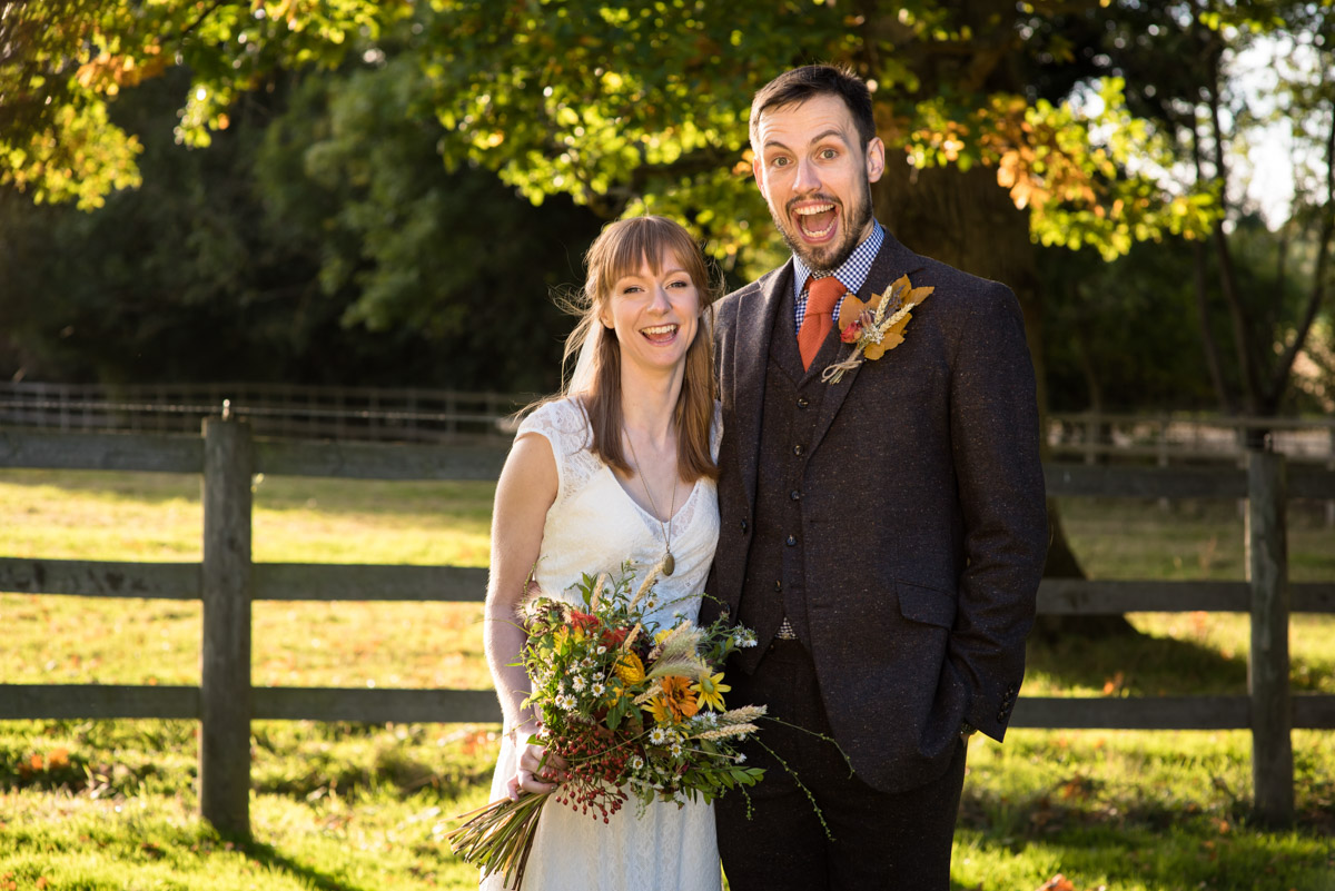 Photograph of Paul and Laura in the grounds of Chilahm Village Hall in Kent on their wedding day