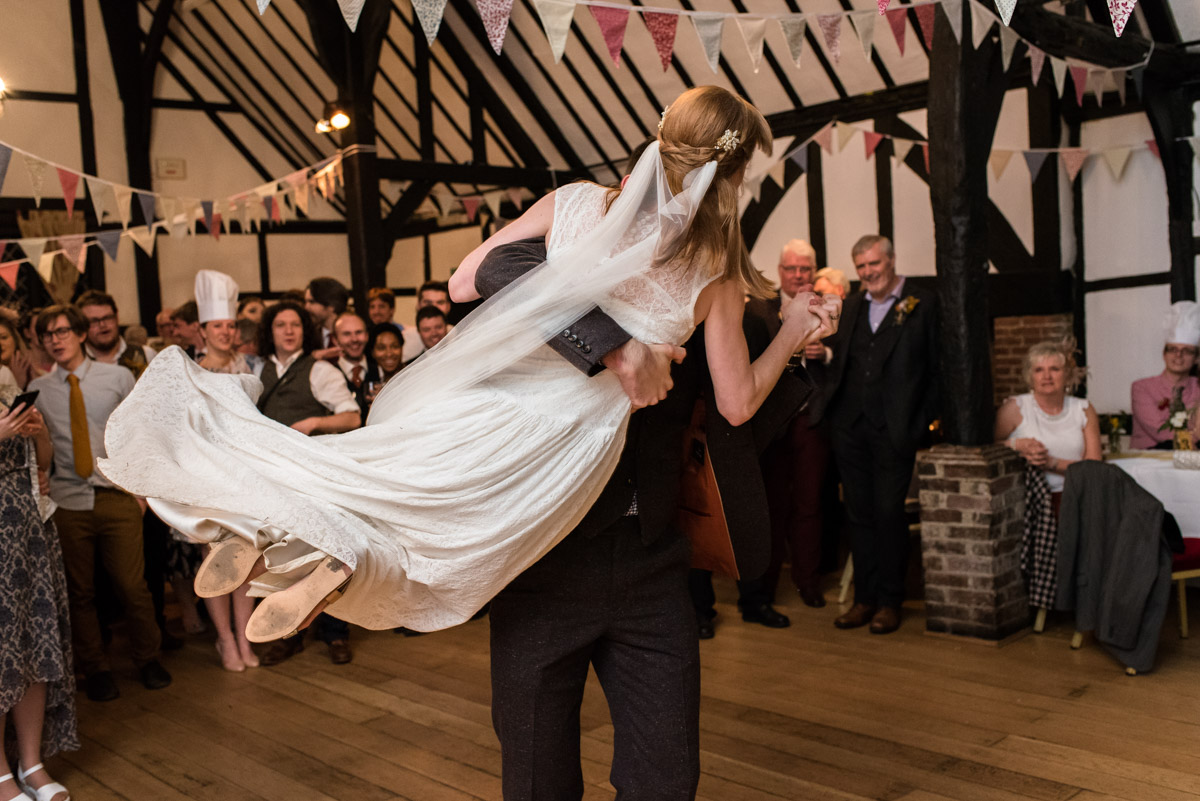 Luara and paul are photographed during their wedding first dance at Chilham Village Hall