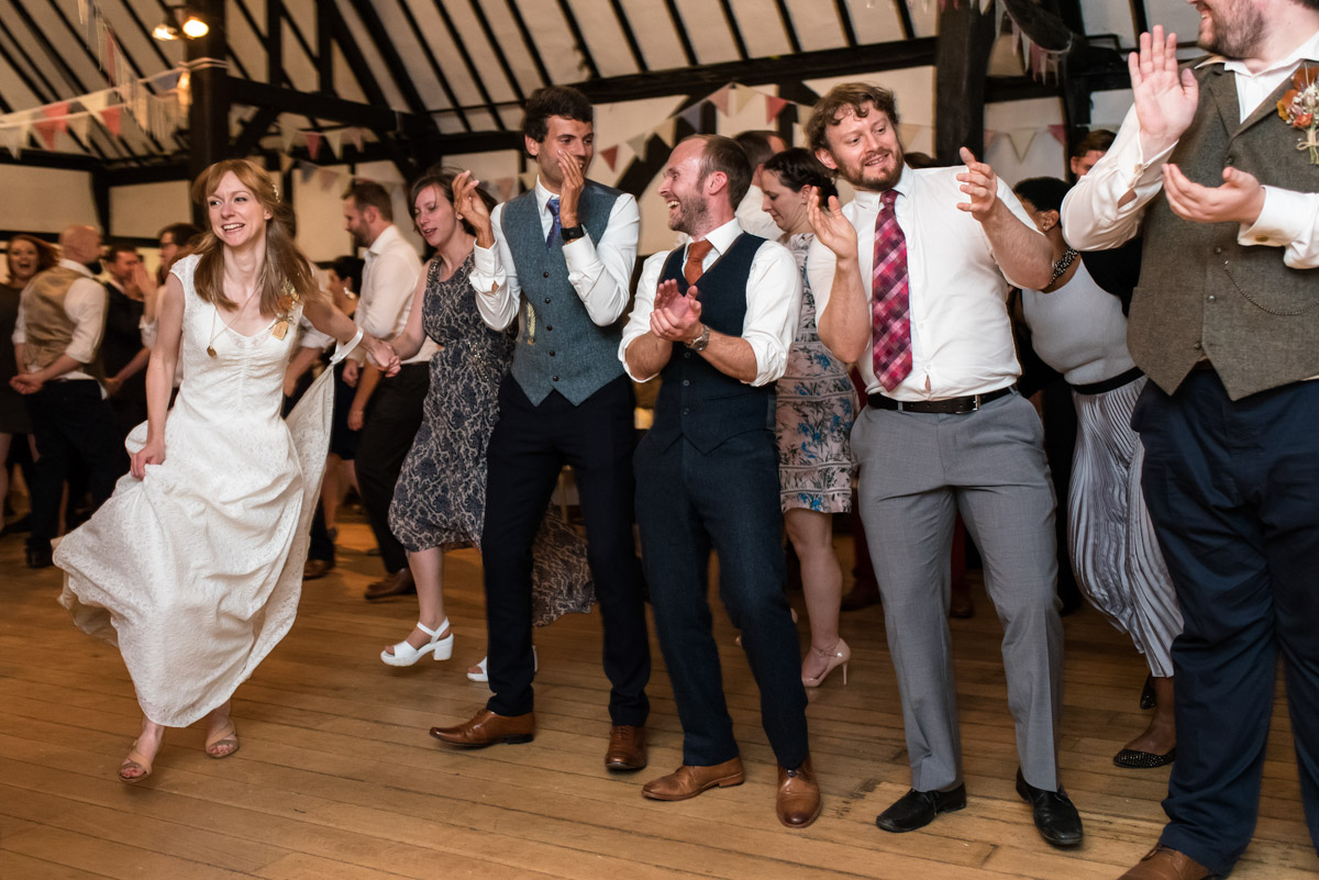 Photograph of Laura and her wedding guests during the ceilidh