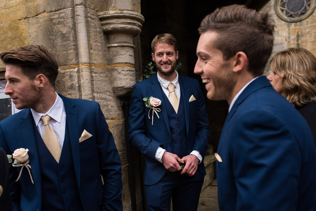 Stuart is photographed with his groomsmen on the day of his Kilndown church wedding in Kent