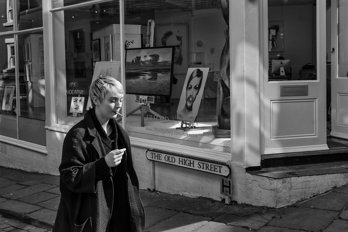 Photograph of young lady smoking a cigaret in Folkestone high street