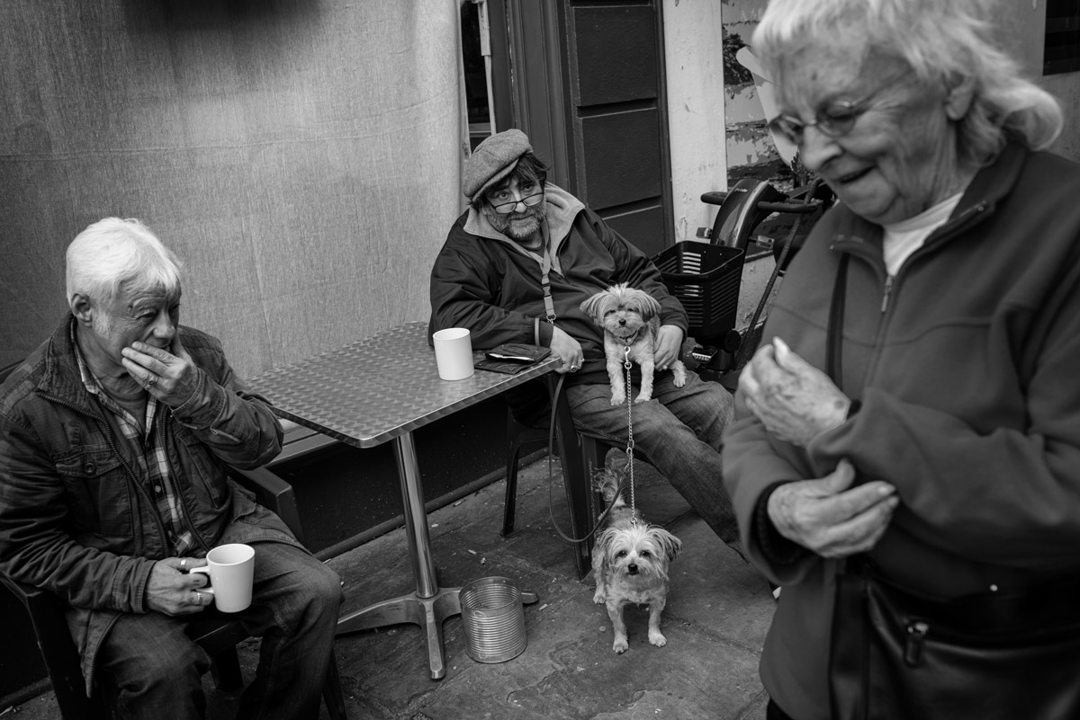 Black and white street photograph of small group of people in Folkestone Kent