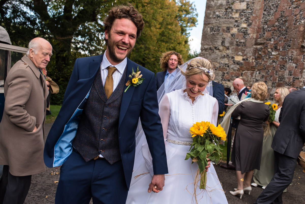 Confetti photograph as Steven and Jane leave the Kent church after their Chilham church wedding in Kent