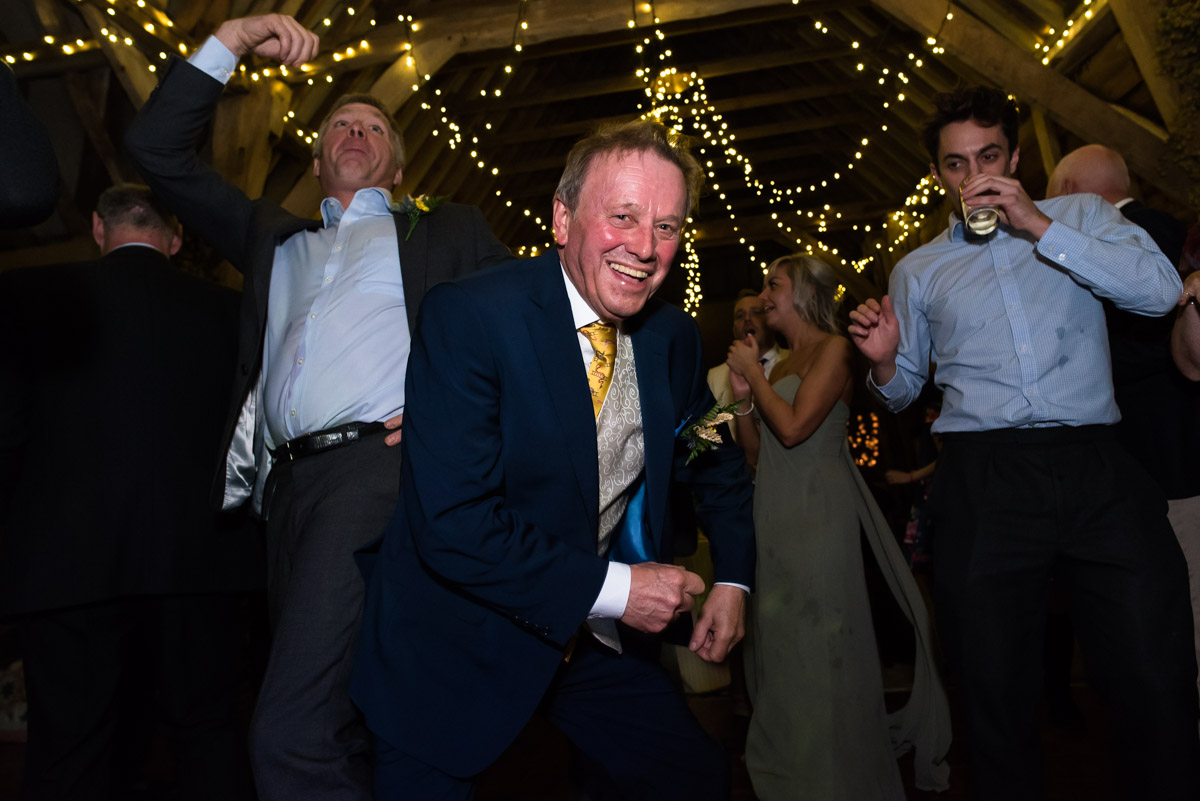 Mike is photographed dancing at his daughters chilham church wedding reception