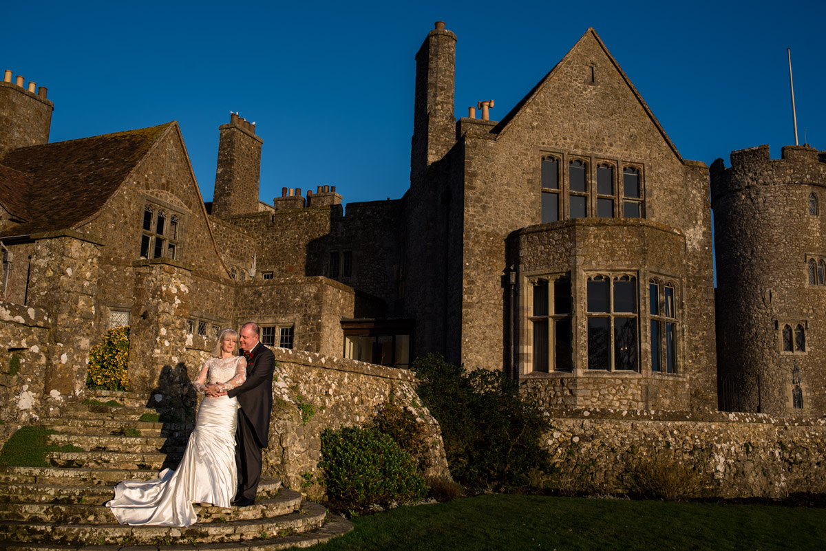 Photograph of Sue and Nick outside Lympne Castle on their wedding day