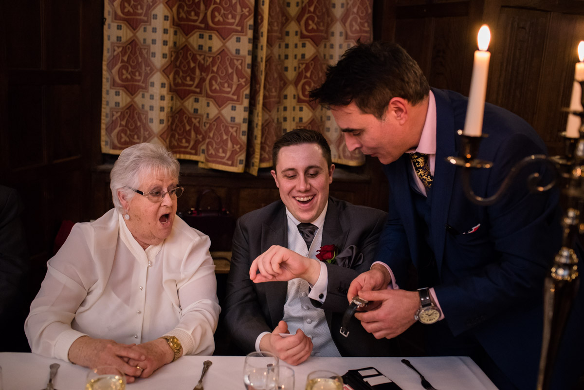 Liam has his watch removed by magician at Sue and Nicks wedding reception in Kent