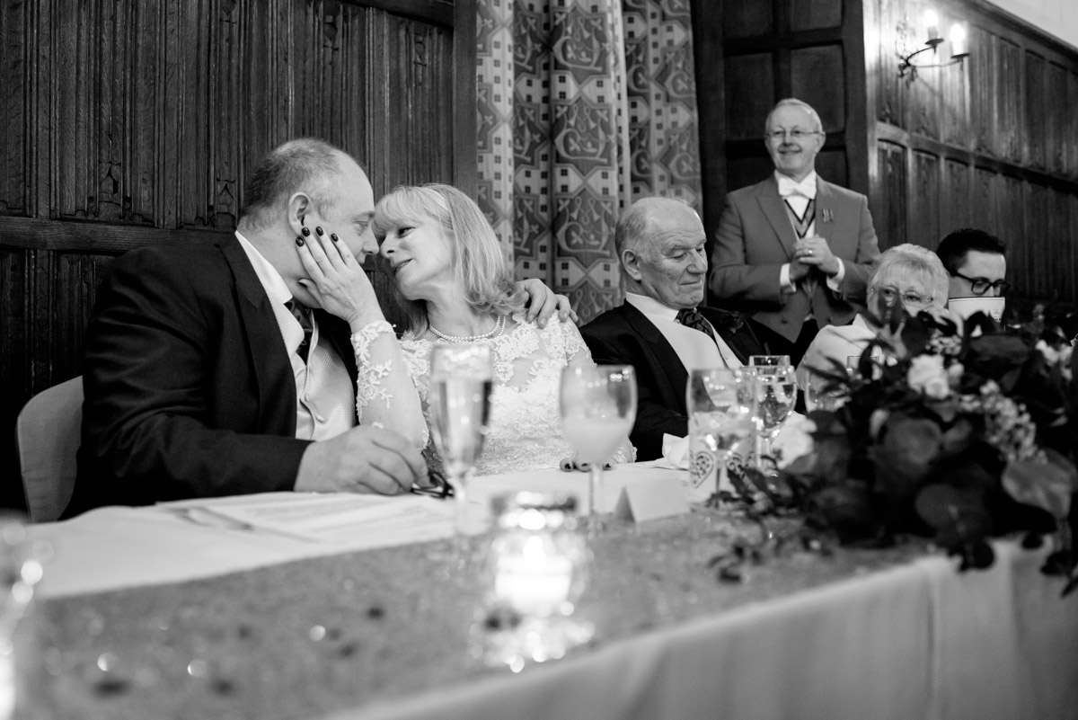 A tender moment between Sue and Nick on their wedding day at Lympne castle