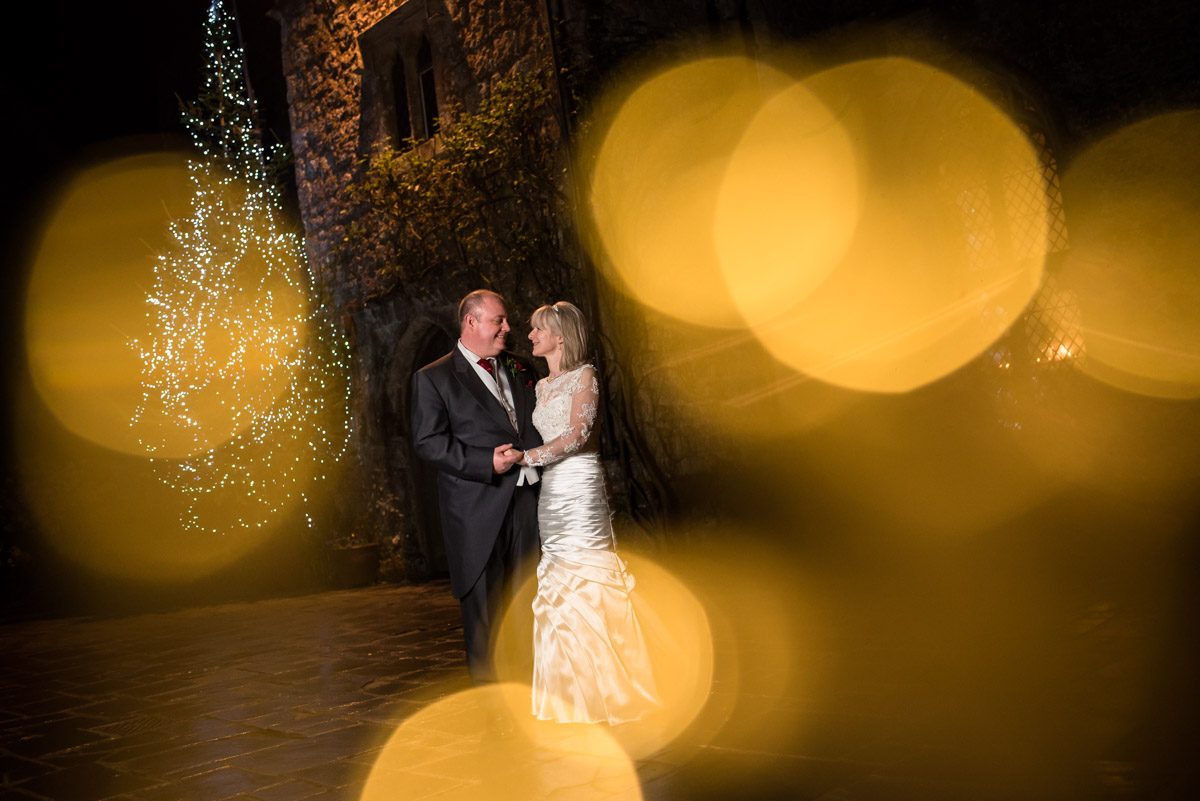Photograph of Sue and Nick at night outside Lympne Castle in Kent