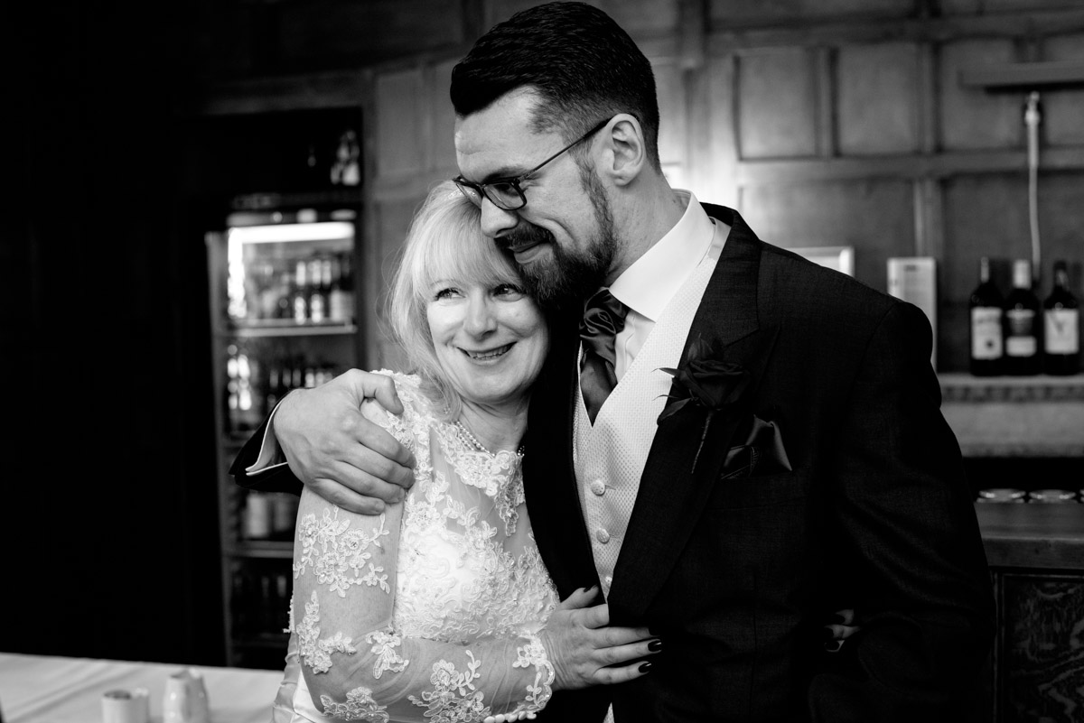 Sue is photographed with her son on her wedding day