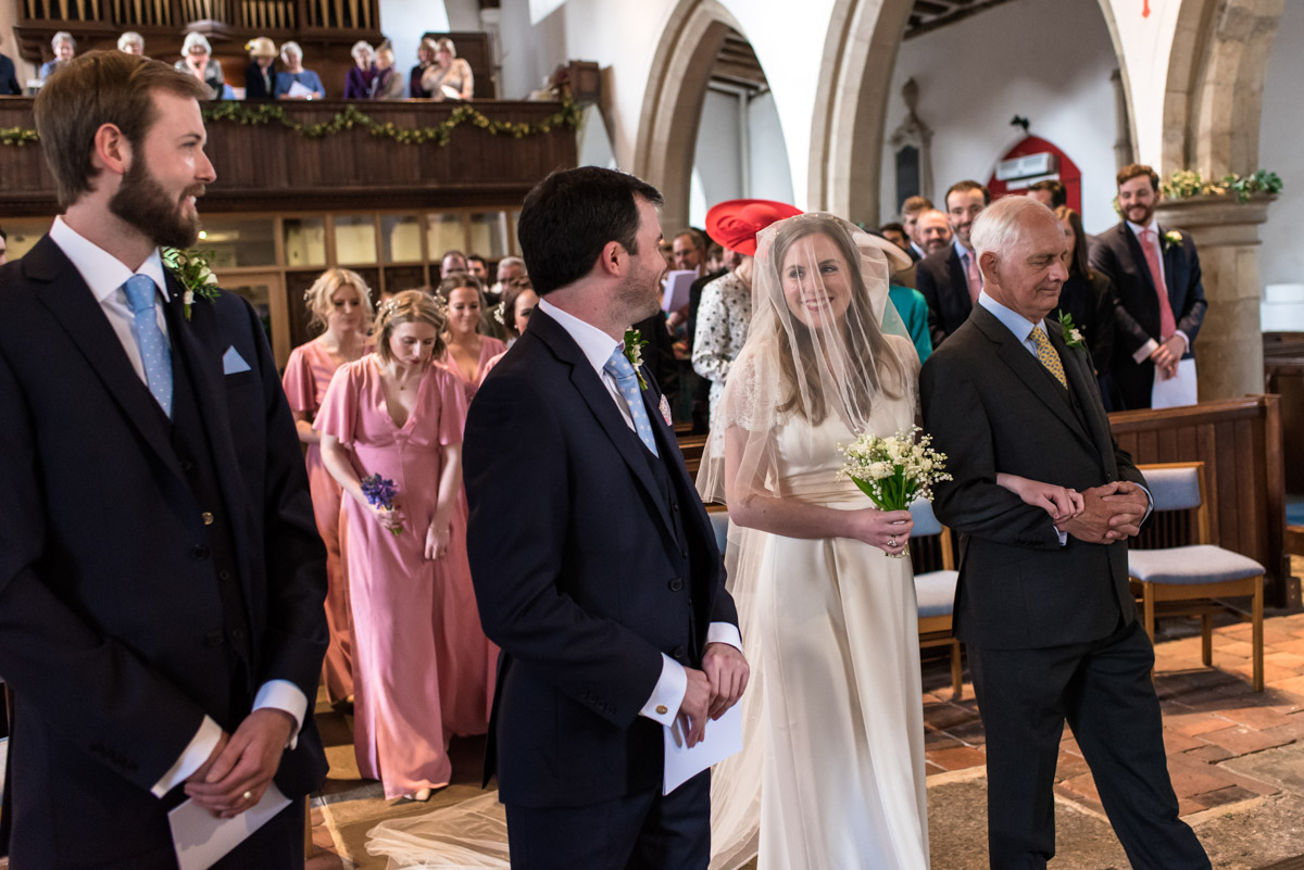 Brenchley Kent wedidng photography of Flora and James during ceremony