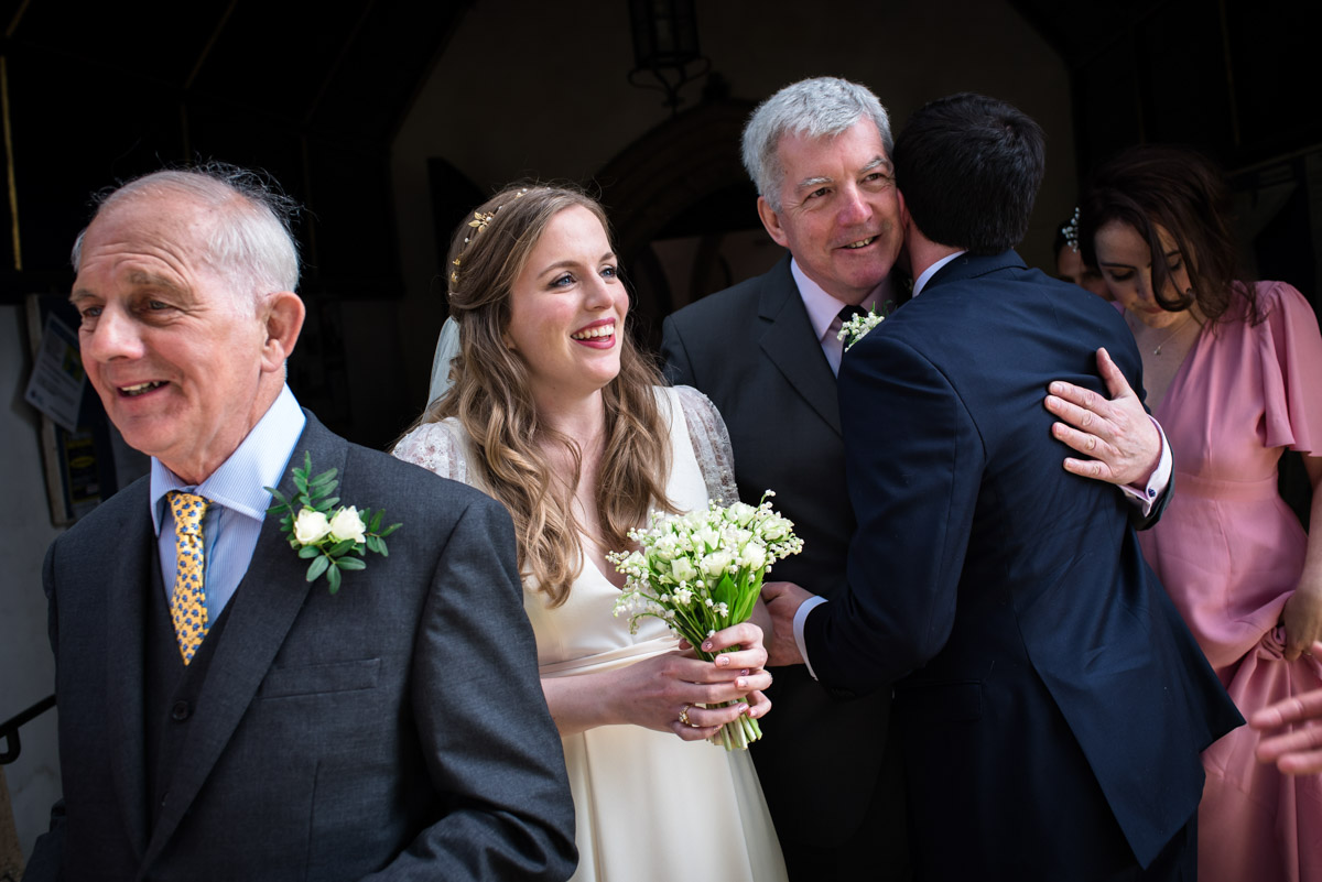 Family congratulate Flora and James after their wedding in Brenchley Kent
