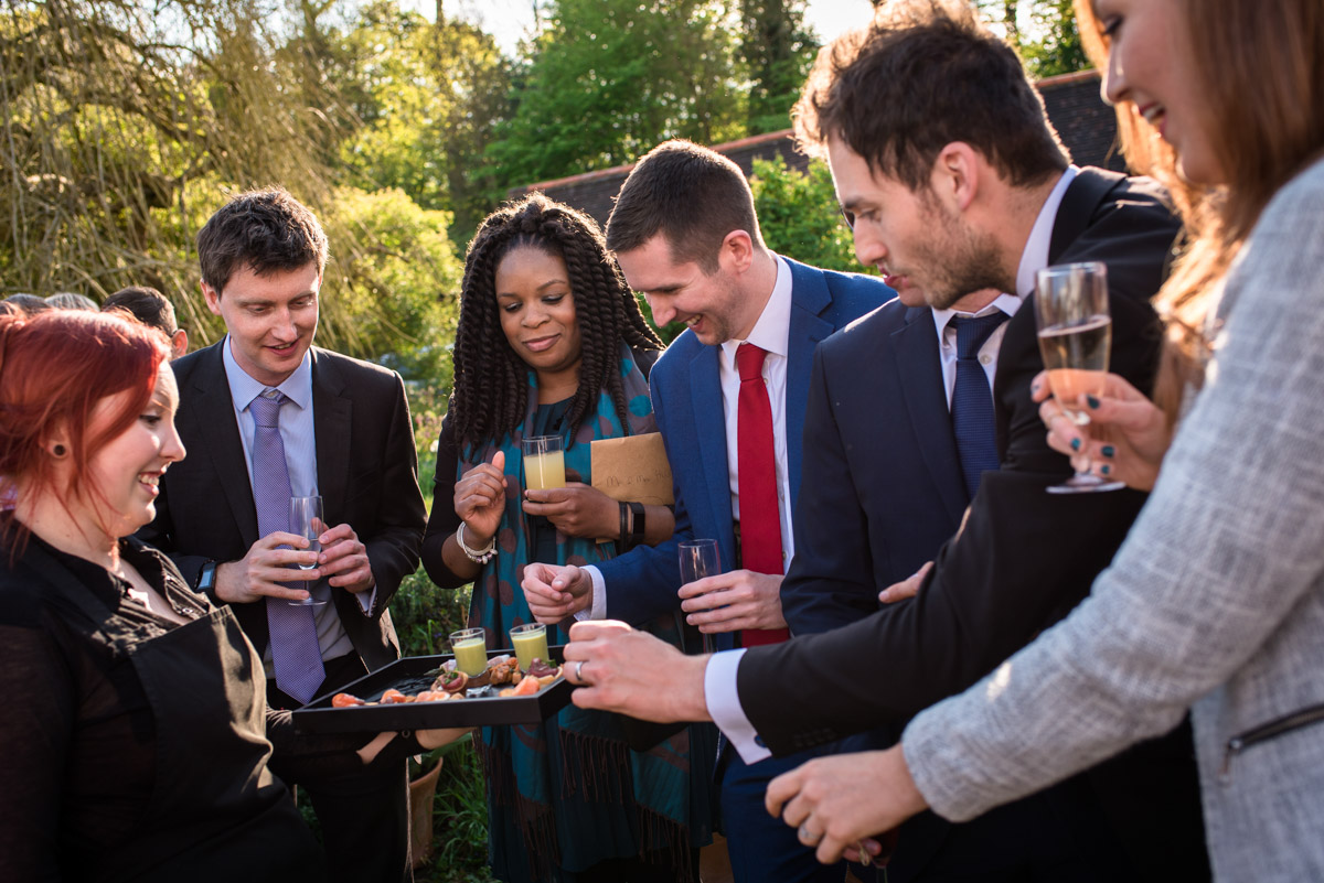 Brenchley Kent wedding photography of guests enjoying drinks reception