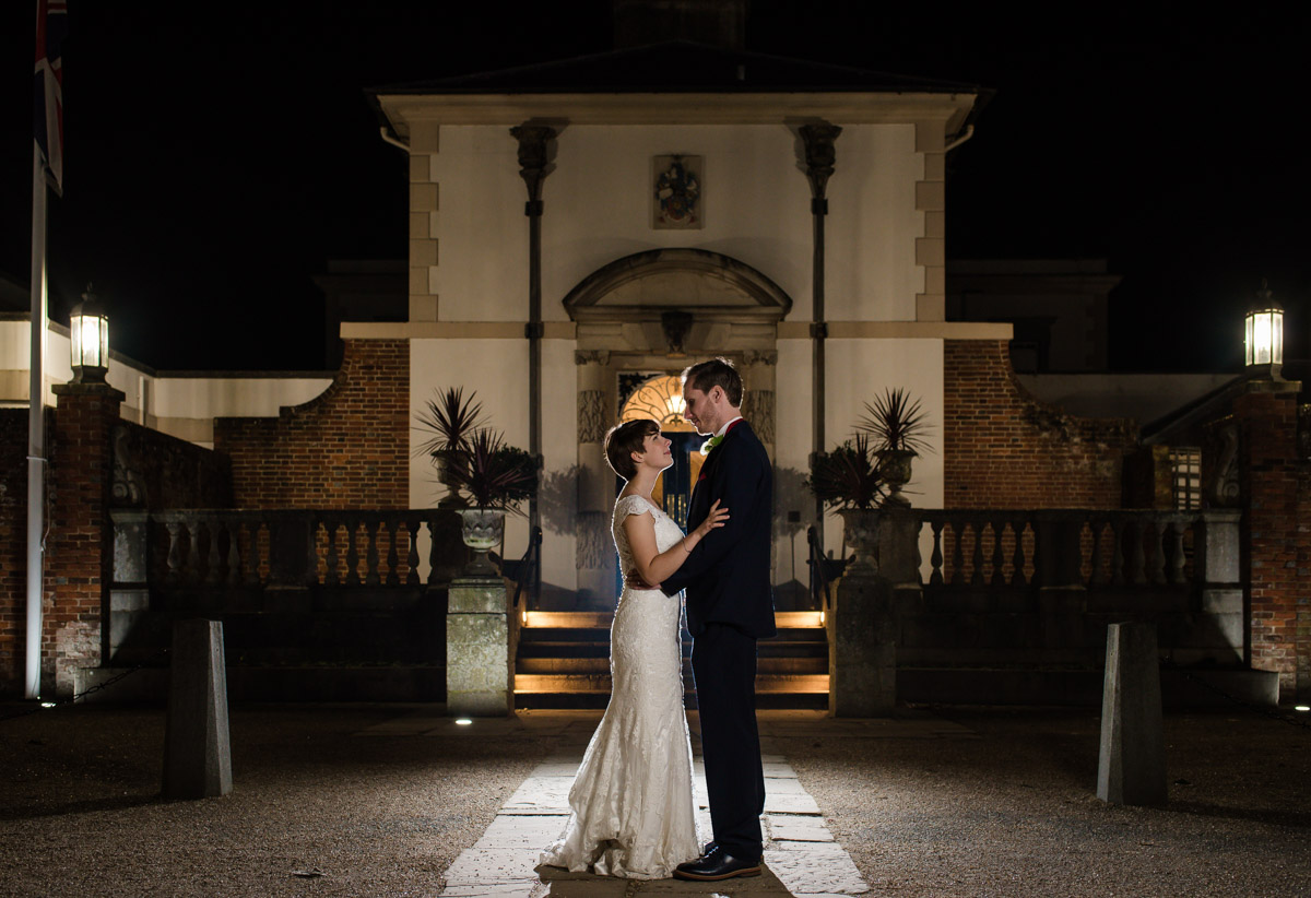 Photograph of Joe and Bennet outside Buxted Park Hotel at night on their wedding day