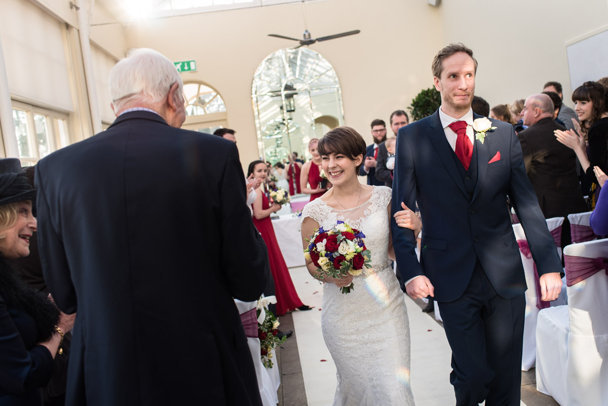 Joe and Bennet photographed leaving the ornery at Buxted Park Hotel after their wedding ceremony