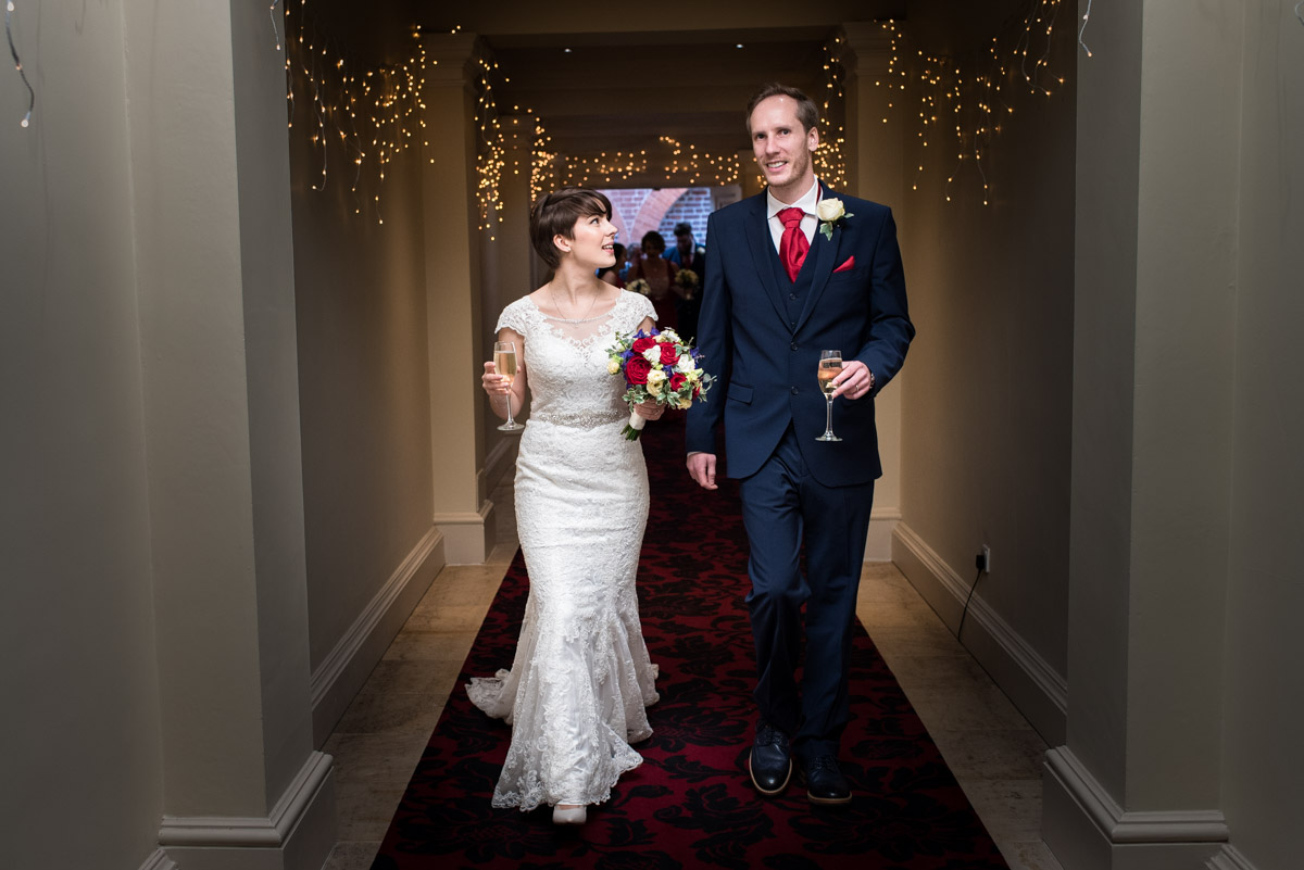 Joe and Bennet photographed after their wedding ceremony at Buxted Park Hotel
