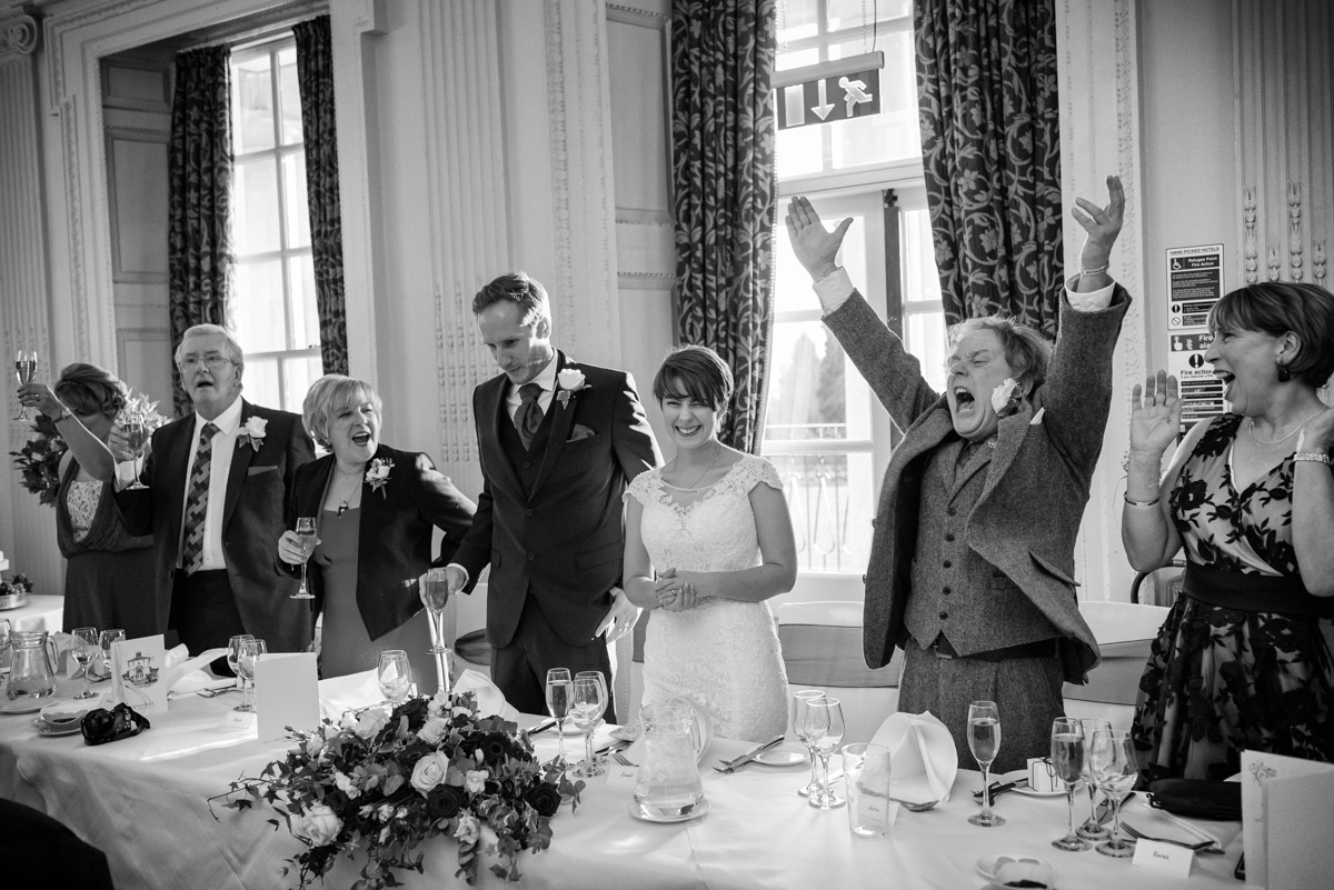Buxted Park Hotel wedding photograph of speeches at Joe and Bennets reception