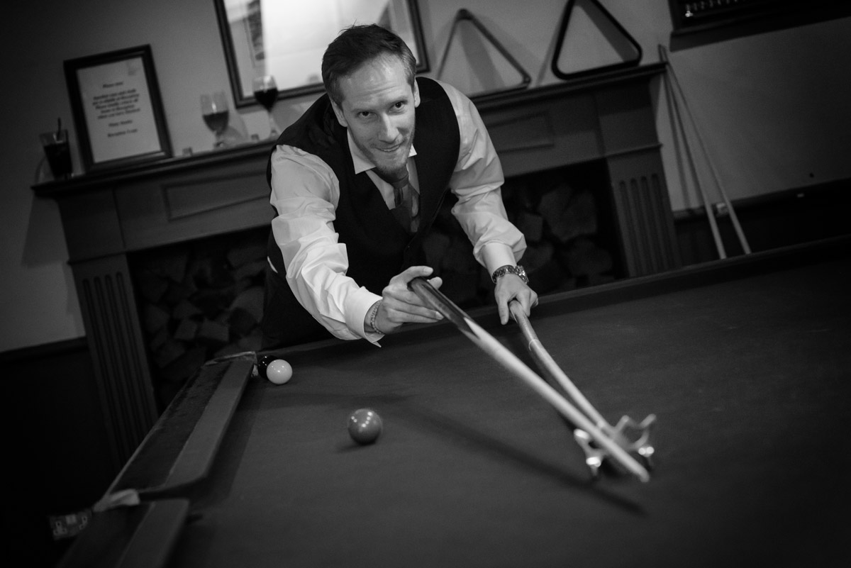 Joe photographed playing snooker before his wedding at Buxted Park Hotel