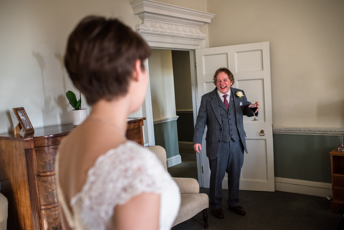father sees his daughter in wedding dress for first time at Buxted Park Hotel