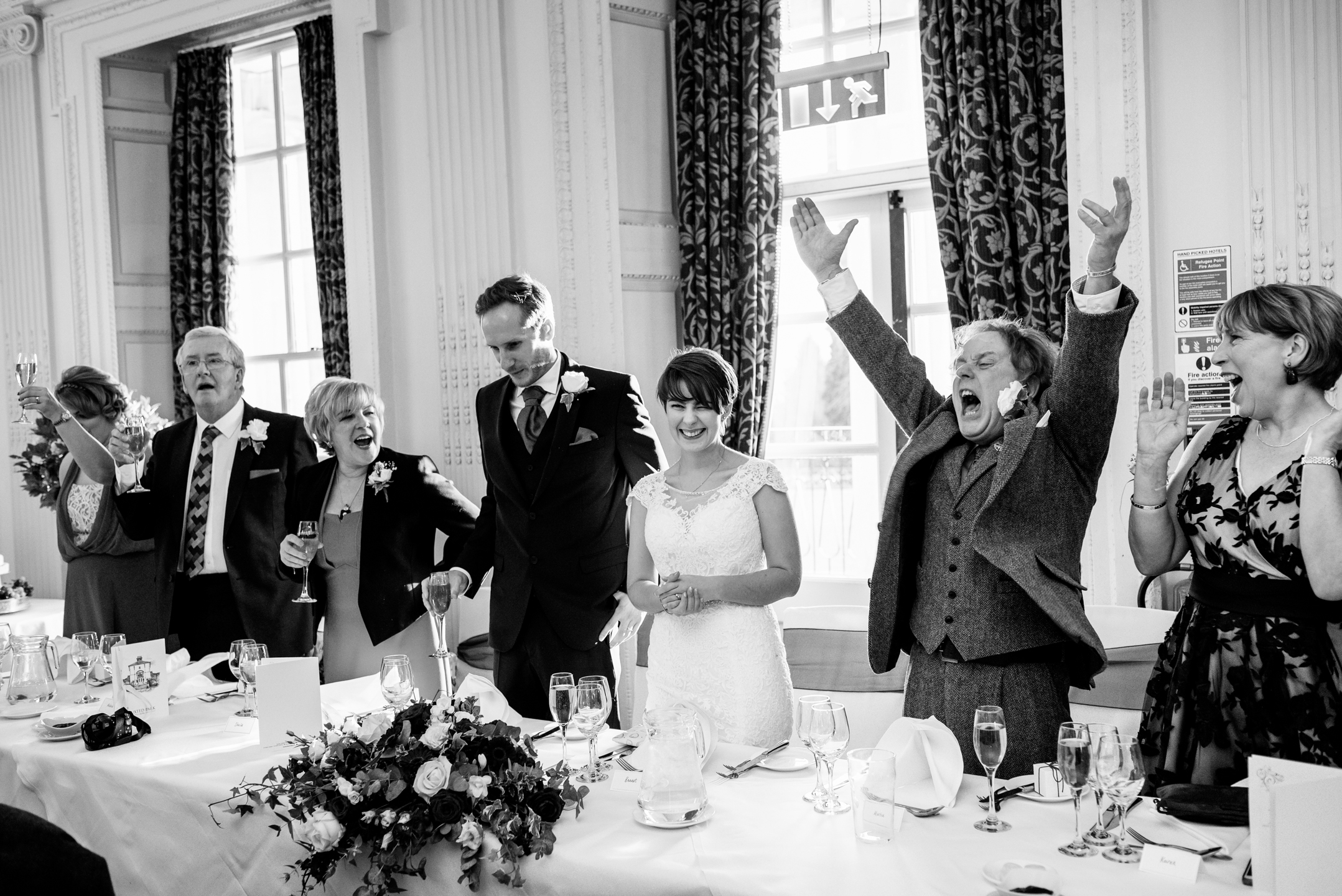 father of the bride cheers Joe & bennet at their wedding at Buxted park Hotel