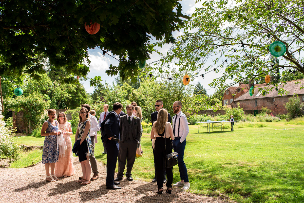 Photograph of wedding guests outside Ratsbury Barn in Kent