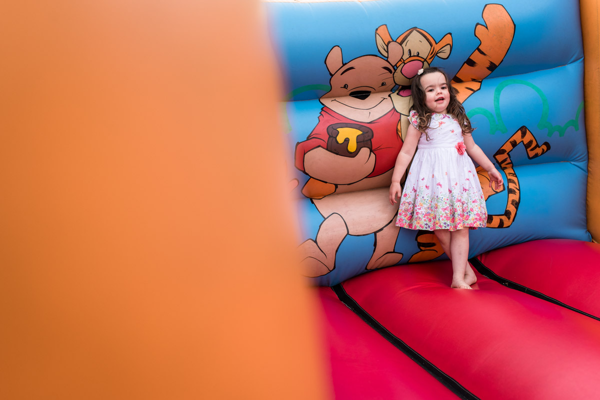 Photograph of flower girl on bouncy castle at rats bury Barn in Kent