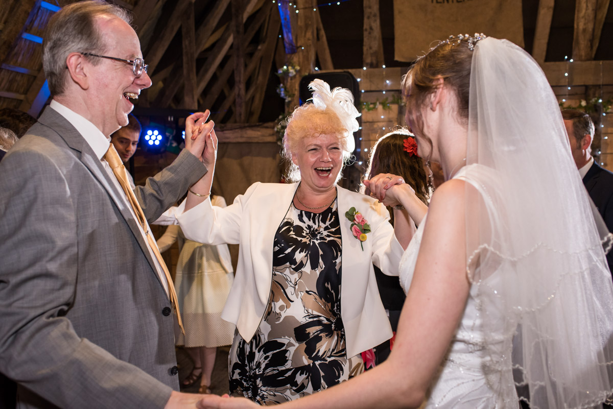 Beth dances with her parents on her wedding day at rats bury barn in Kent