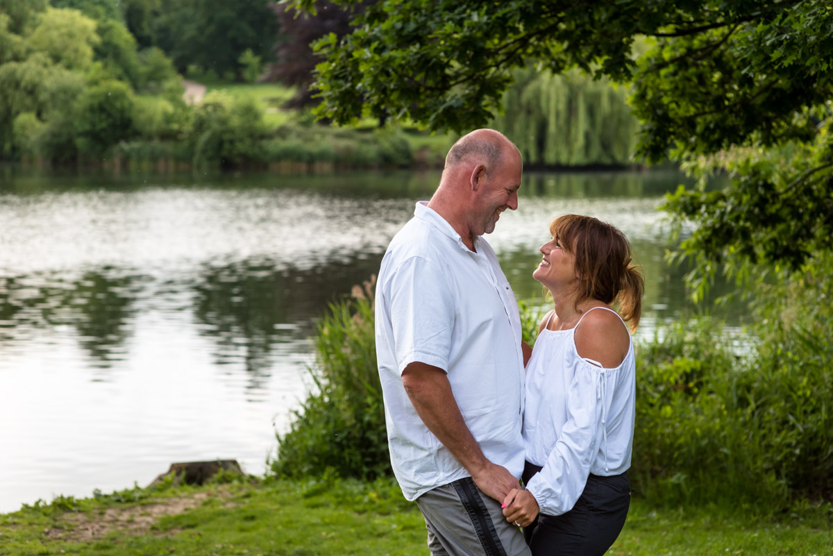Pre wedding photography at Moat park in Kent, Debbie & Martin stand holding hands