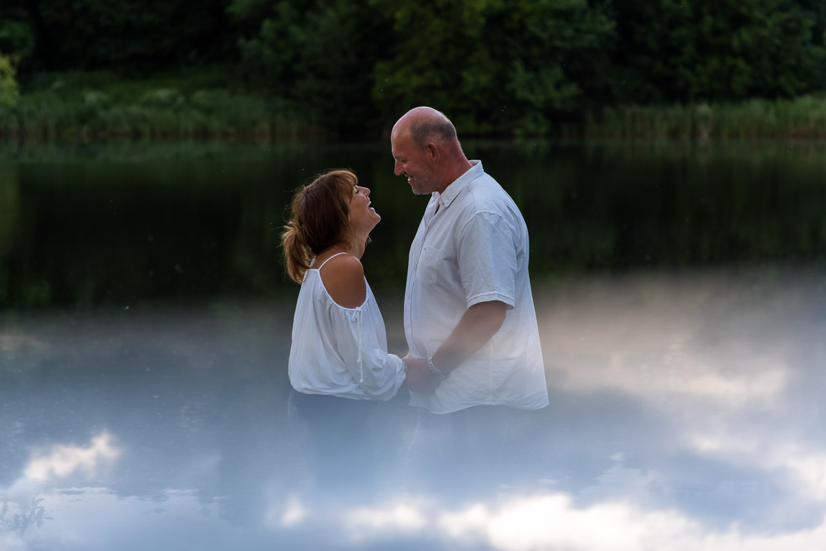 Pre wedding photography at Moat park in Kent, Debbie and Martin photographed by the lake