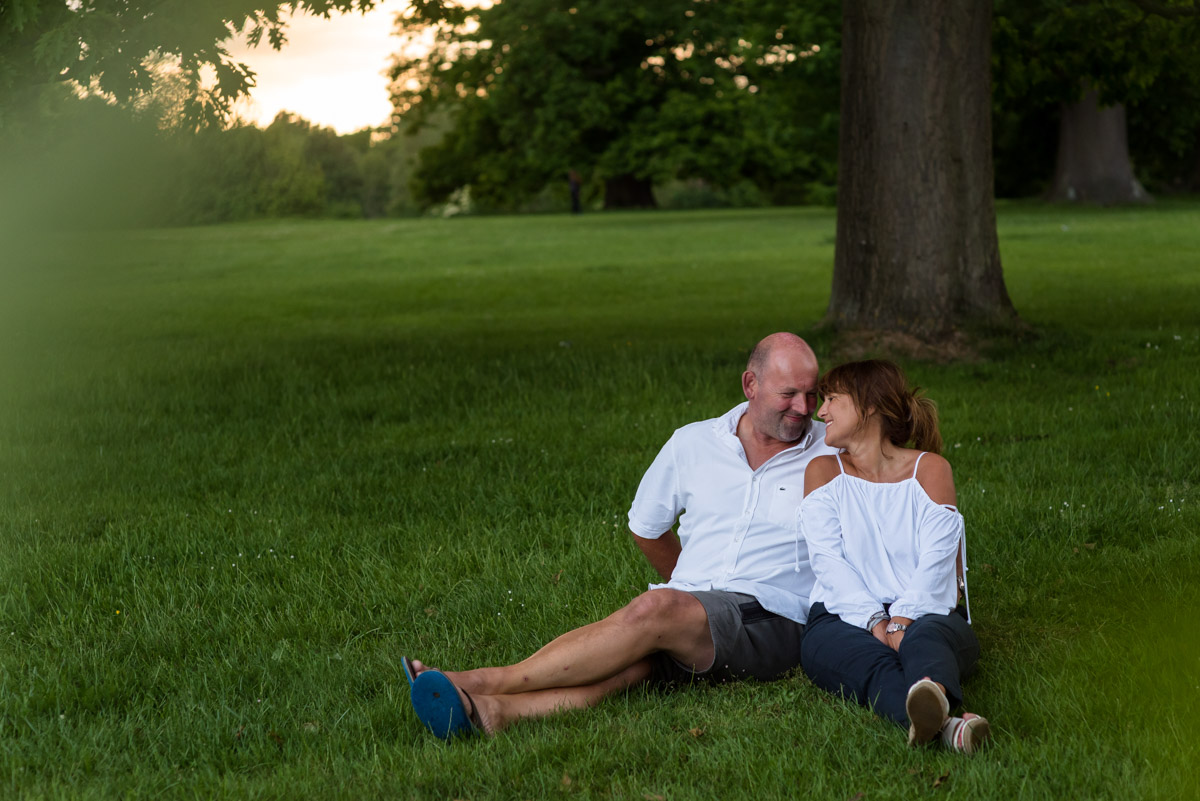 Debbie and Martin photographed sitting under the trees at moat park in kent