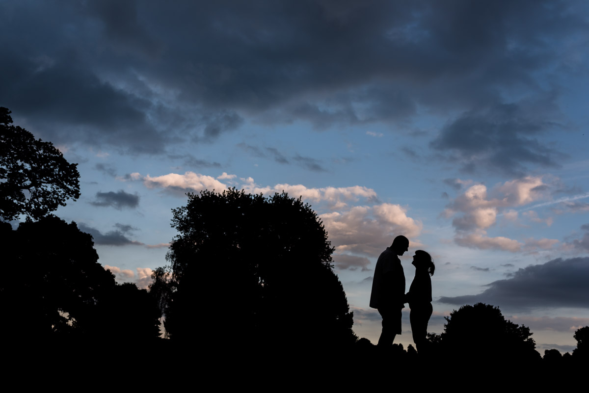 Silhouette of Debbie and Martin at their pre wedding photography shoot at Moat park in Kent