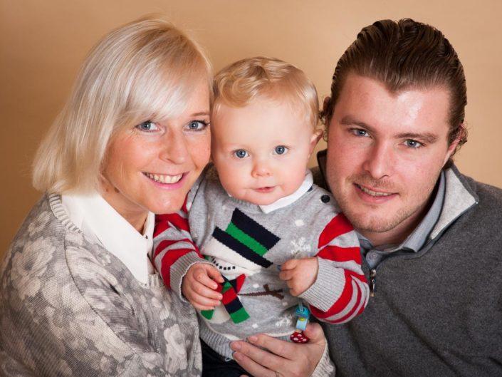 Studio portrait of Louis and his family taken at Helen Batts photography studio in Kent