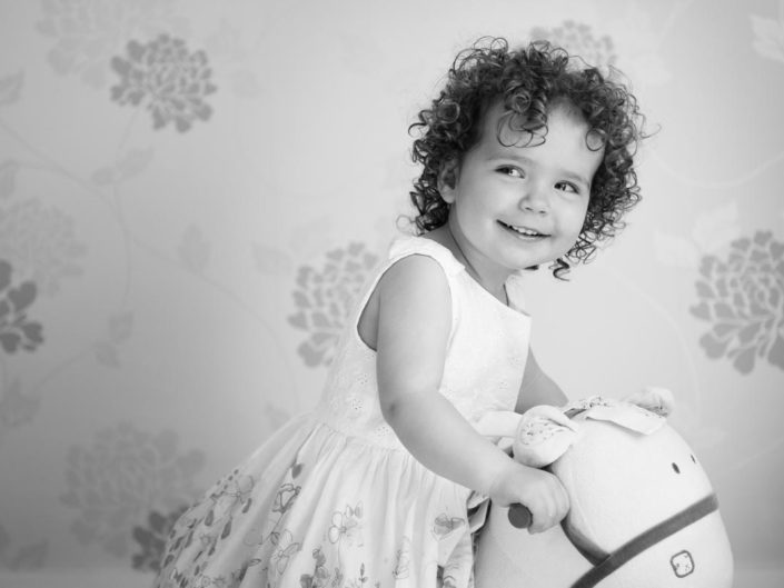 primrose is photographed on rocking horse in her home in Kent