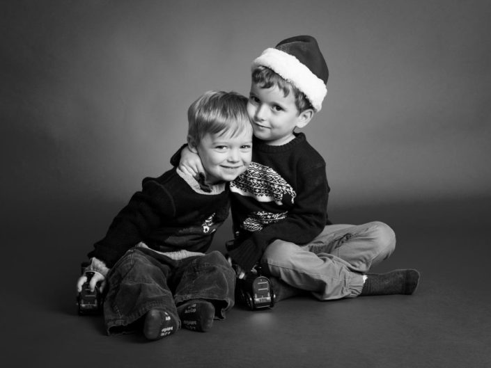 Studio photography of two small children in Christmas hat