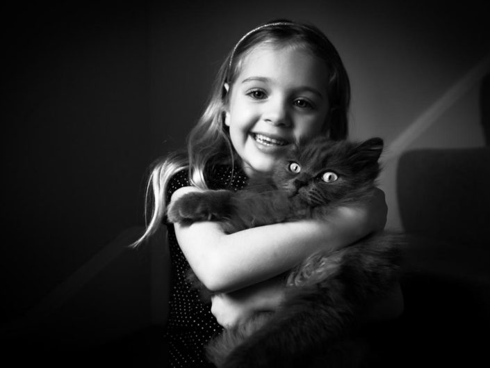 natural light child portrait of Bella and her pet cat