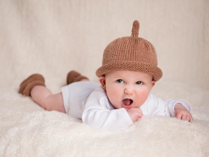 Baby studio portrait photography of little boy in wooly hat