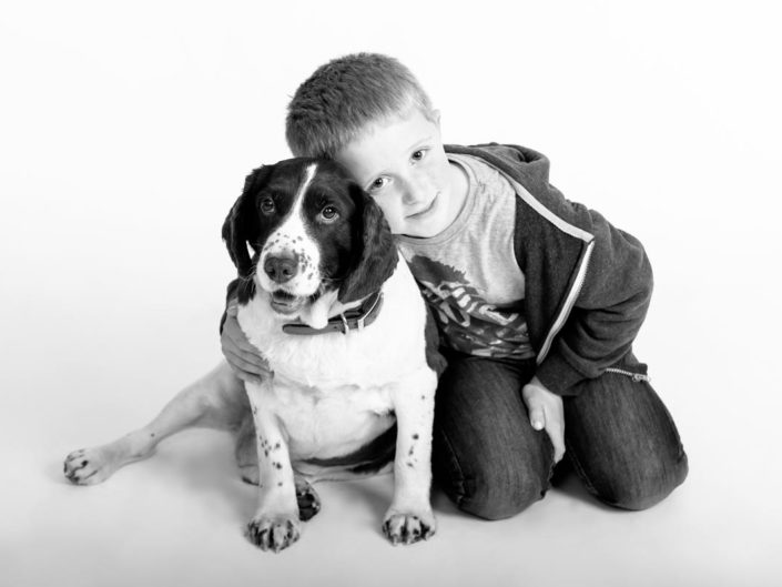 Harry and his dog photographed in studio in Kent by Kent photographer Helen Batt
