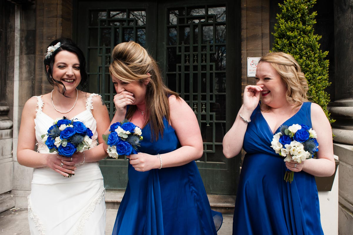 Bride and bridesmaids giggling, London wedding photography