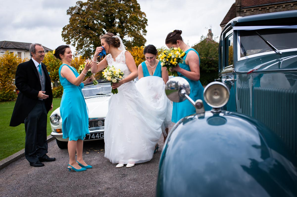 Bridesmaids helps bride blow her nose before her wedding in Tunbridge wells Kent