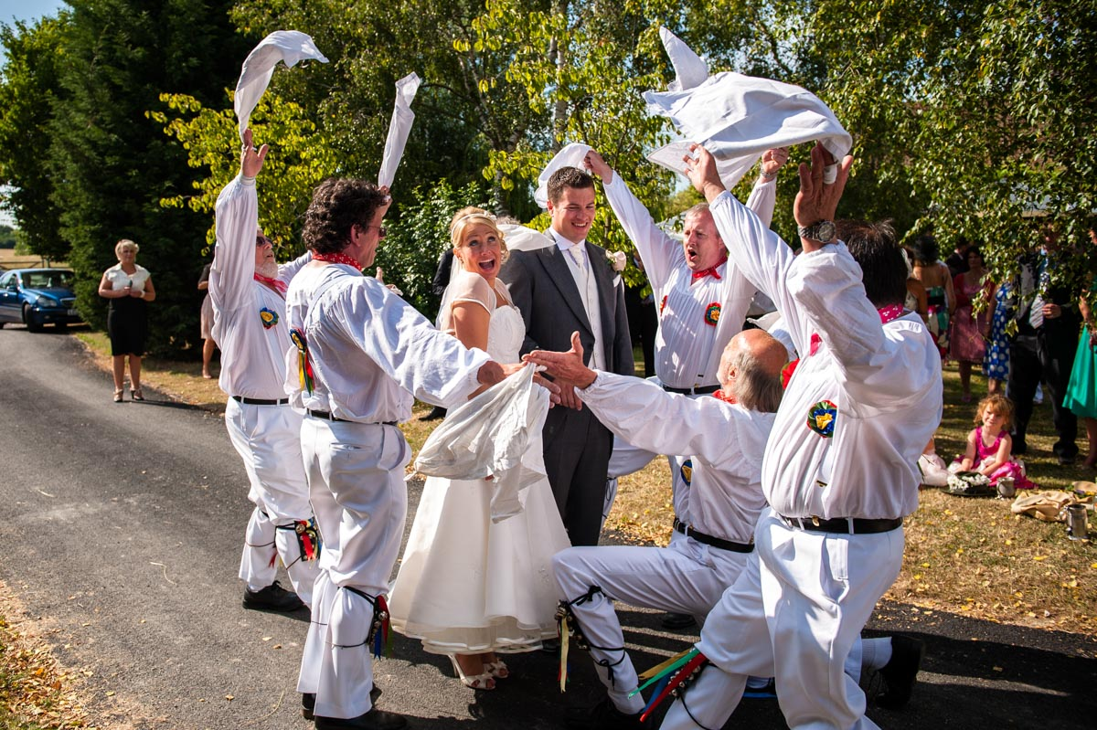 Morris dancers photographed at Kent summer wedding