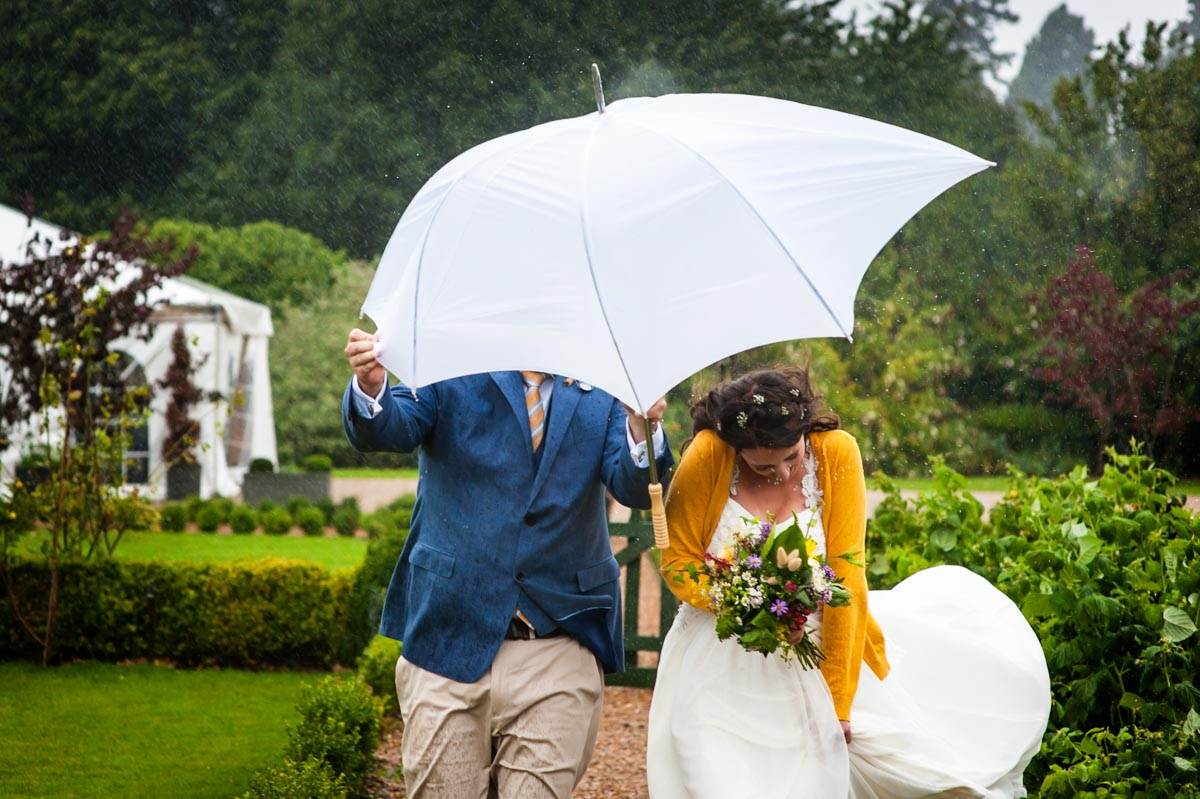 Wet summer wedding at The Secret garden in Kent