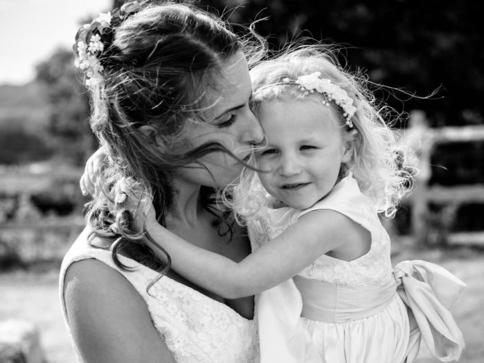Bride and her flower girl photographed together