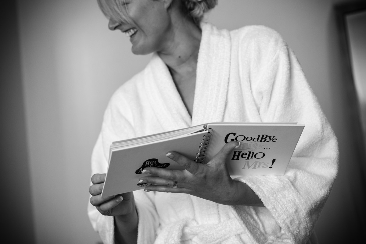 Black and white photograph of Lexy getting ready before her Kent wedding at Allington Castle