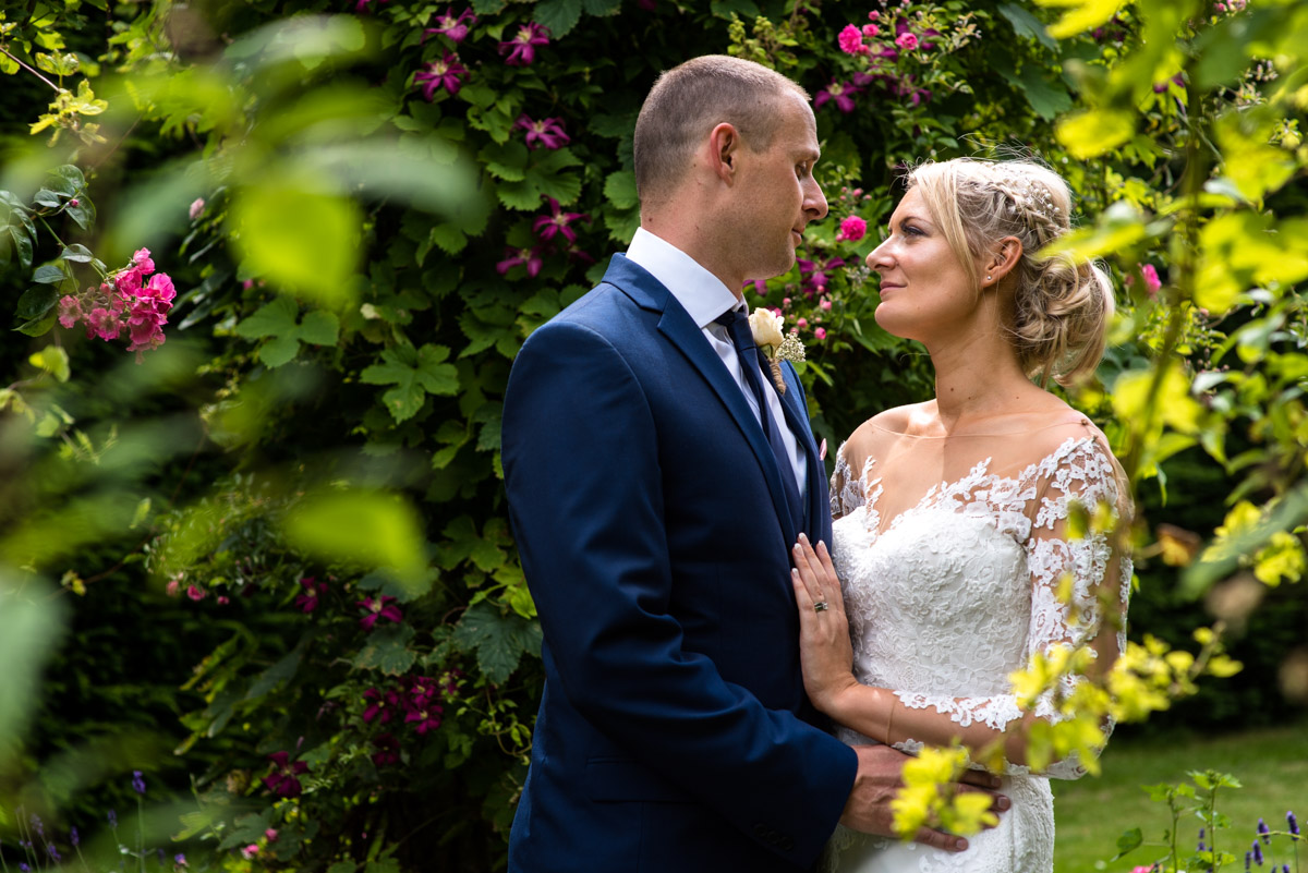 Paul and Lexy photographed togetehr in the Italian Gardens at Kent wedding venue Allington Castle